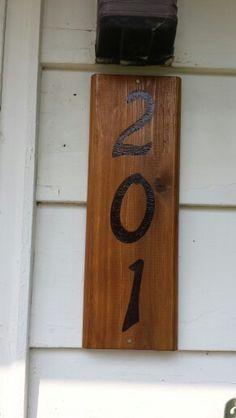 House number. Woodburning.