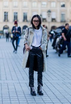 Yoyo Cao is wearing a fur coat Louis Vuitton bag and black latex pants outside Louis Vuitton on October 5 2016 in Paris France
