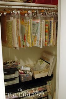 store paper in 2 gallon bags and hang from pants hangers on a closet rod in the craft room