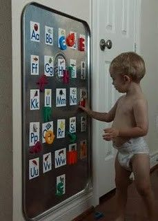 Oil drip pan from Autozone as a giant magnet board; glue alphabet flashcards to pan, then use magnetic ABCs to match ($9.99)