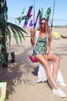 Model Ashley Galeyn hangs out with us at our festival beach. How cute is her H&M palm leaf romper? | H&M Loves Music