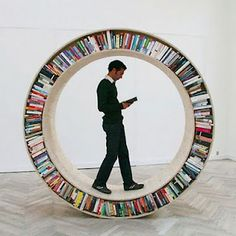 "Listed as a ""gerbil wheel for humans""--circle bookcase.  Libreria a ruota"
