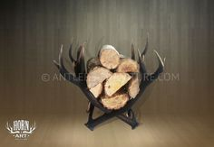 We'll take one... and a fireplace ;) Antler Firewood Rack from HornArt.