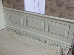 Miniature wainscoting made from cereal boxes & painted popsicle stick floor.