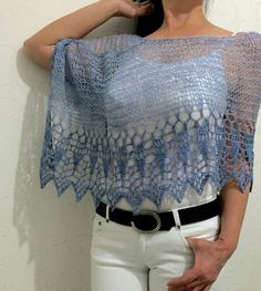Wool poncho, wool woman poncho, blue lace wrap, cape, shawl, wrap, wedding wrap, bridal poncho, loose knitting, light weight top This wool poncho made of a warn mixture of alpaca, merino and acrylic. It is so light weight that you wont even feel that you are wearing it. It is light but cozy