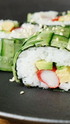 Recipe with video instructions: This sushi roll is as cool as a cucumber — mainly because it's wrapped in one. Ingredients: 1 cucumber, 1 sheet nori, 200 grams sushi rice, 3 slices avocado, 3...