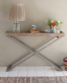 Loaf's reclaimed wooden console table with industrial metal legs in this lovely, natural hallway