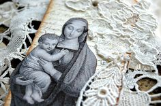 Vintage French-style tag depicting Madonna and Child, embellished with lace, ribbon, and religious medal