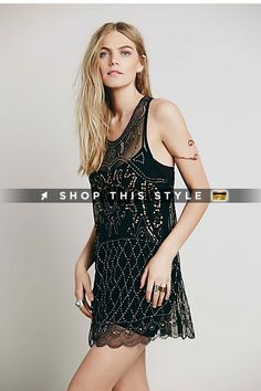 Sheer mesh scalloped hem slip featuring allover embellishment detailing featuring bead and sequins. Racerback and dropped armholes. #FreePeople #Day