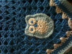 Crochet a little owl for this baby blanket! X