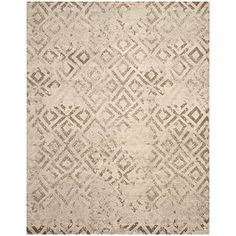 Safavieh Tunisia Collection TUN1911-KMK Ivory Area Rug, 9-Feet by 12-Feet Safavieh http://www.amazon.com/dp/B00NR3E2PQ/ref=cm_sw_r_pi_dp_R9O7ub06KT6S9