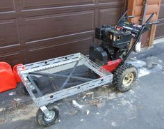 Powered Wagon by SWNH -- Homemade powered wagon constructed from a snowblower, angle iron, and casters. http://www.homemadetools.net/homemade-powered-wagon