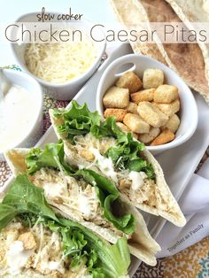 SLOW COOKER CHICKEN CAESAR PITAS   shredded caesar chicken inside a pita. Top with croutons, romaine lettuce, and parmesan cheese! www.togetherasfamily.com