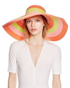 """Eric Javits' bright-as-sunshine hat complements beach-chic maillots and gauzy wraps. 