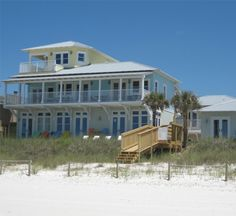 Coastal Commodity in Panama City Beach, Florida accommodates up to 32 guests.  This beachfront rental home features spectacular Gulf views from almost every room, private beach access and a 10 person private hot tub with a large patio, outdoor summer kitchen with grill and parking for six cars. Coastal Commodity is comprised of four separate buildings, the main house, Sand Castle, the cottage, Seaside Cottage, the Carriage House and the efficiency, Beachside Bungalow.