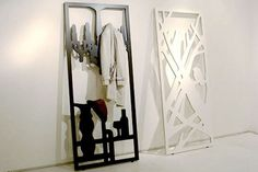 Frame Hanger - a beautifully crafted piece of art, a coat rack and place to hang accessories.   For versatility, flip the piece around and you'll get another colored frame hanger - chandelier (black/white) or tree (green/white).