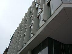 Naturstein i fasader levert av Naturstein Montering AS Multi Story Building, Natural Stones