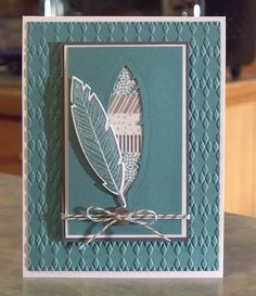 Because of the new Lost Lagoon & the Basic Gray colors, this card would work well for a feminine or a masculine birthday.  The card that measures 5 1/2 x 4 1/4, with all images & wording being hand stamped. I used the stamp sets Four Feathers & Fabulous Four by Stampin Up, card stocks, inks, a feather die, an embossing folder, All is Calm washi tape for the die cut feather, bakers twine & a silver metal button.  Inside: Blank inside so you can add your own sentiment....
