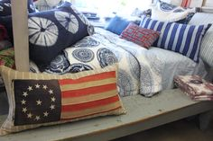 Vintage flag pillow at Blue Springs Home.