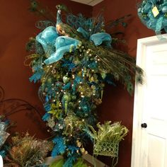 Obsessed. I NEED this upside down  peacock Christmas tree!!