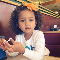 cute mixed girl with curly hair