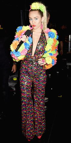 All of Miley Cyrus' OMG VMAs Outfits | THE BEADED JUMPSUIT | Naked Level: 1 This is basically church-appropriate for the star.