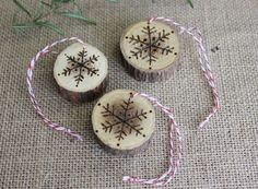 Add a rustic touch to any Christmas tree or gift with these wood burned ornaments or gift tags featuring hand-drawn snowflakes.