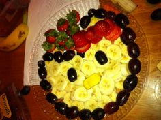 Hello kitty fruit tray with bananas grapes and strawberries