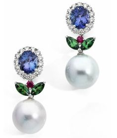 MAX PRUS. pair of earrings in white gold each adorned with a tanzanite surrounded by brilliant-cut diamonds, holding a cultured pearl of the South Seas topped with two shuttles peridot and ruby. Systems for pierced ears. (Small égrisure). Signed Max Prus