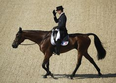 Astier Nicolas, of France, reacts on Piaf de b'Neville after competing in the equestrian eventing dressage competition at the 2016 Summer Olympics in Rio de Janeiro, Brazil, Saturday, Aug. 6, 2016. (AP Photo/John Locher)