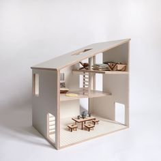 Simple and modern doll house with 3 floor and scales to play with playmobil, sylvanian and other small doll (between 8 and 12 cm)  This doll house in plywood coated with a white plastic film is easy to clean and a good support to imagination.  Delivered without furniture and doll.  Size: 48 x 38 x 28 cm material: birch plywood coated with white plastic film 9mm cutted and engraved with cnc milling.  for children aged over 3 years.