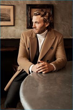 Brad Kroenig dons a double-breasted coat with a turtleneck from Club Monaco's…