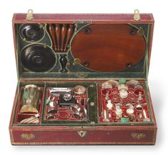 A DIRECTOIRE MOTHER-OF-PEARL, SILVER AND GOLD-MOUNTED MINIATURE COOKING AND DINING EQUIPAGE, Lebrun, Paris, circa 1800 comprising: A mantelpiece with enameled gold insets, overmantle mirror, and fender A kitchen equipage including copper, five sauce pans and lids, skillets, coffee grinder, roast cover, stewpot, and collander An oval mahogany dining table with gold-mounted mother-of-pearl dinner service including pair of candlesticks, soup tureen and cover, ewer, plates, platters and dishes,