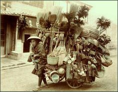 Vintage photo of Japanese brooms, brushes and basket vendor. Okinawa Soba