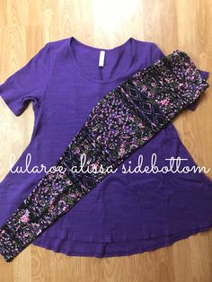 Lularoe leggings paired with a heather purple and black perfect T