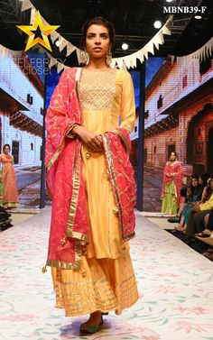 Our Yellow sharara set has an old world charm with its exquisite hand work and lustrous chanderi fabric perfect for festive. It is well tailored and finely finished with elegant gota,dabka and pearl work. The contrast hot pink dupatta comes with handwork gota work at the edges, adding a dash of drama to this classic timeless piece. Color may slightly be different from the actual item due to photographic lighting sources or the monitor's settings. Designer Punjabi Suits, Designer Silk Sarees, Indian Designer Wear, Mehendi Outfits, Bridal Outfits, Indian Attire, Indian Wear, Indian Dresses, Indian Outfits