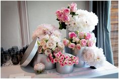 Pink floral wedding displa, dusky pink roses in silver hat boxes - © Fred Marigaux Photos