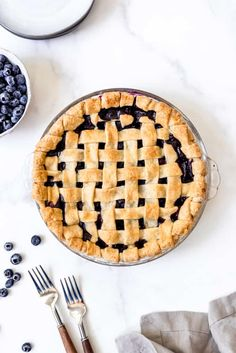 Deliciously sweet and juicy with a buttery, flaky crust, nothing quite compares to a classic Homemade Blueberry Pie! It's the ultimate summer dessert with plump, fresh or frozen blueberries for an easy blueberry pie filling and my perfect pie crust that wins every time! #pie #blueberries #blueberrypie #best #recipe #easy #fresh #frozen #fromscratch #homemade Strawberry Blueberry Pie, Best Blueberry Pie Recipe, Homemade Blueberry Pie, Blueberry Recipes, Homemade Pie, Best Manicotti Recipe, Lattice Pie Crust, Perfect Pie Crust, Cream Pie Recipes