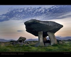 Kilclooney Dolmen    This is one of Ireland's most spectacular dolmens in Co Donegal. Since it is not well-known, a visit to the Kilclooney dolmen is very peaceful and without the annoyance of the tour bus crowds that sometimes detract from visits to the more famous megalithic sites around the Ireland like the Burren.