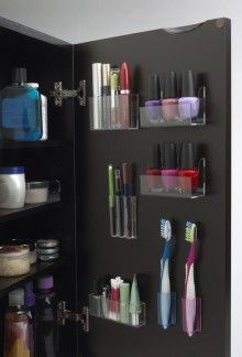 Awesome idea - stick on pods for makeup, toothbrush, nail polish.