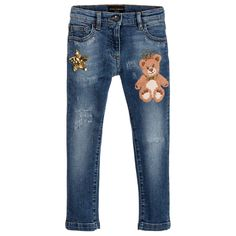 Girls distressed, faded blue jeans by Dolce & Gabbana, featuring an embroidered teddy bear and gold sequin star on the front and a crown appliqué at the back. Made in cotton denim with added elastane for stretch, these slim fit jeans have a zip and logo button fastening, with an adjustable waistband and five pockets.
