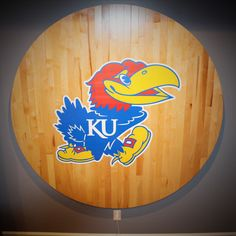 6' diameter made with real wood from a basketball court. My husband made it as wall art for my KU obsessed teen!   Searching for Moments