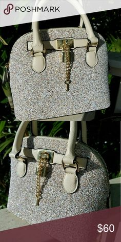 Aldo purse Soooo cute and very sparkly and lock and key works..... Size small  TRADE VALUE $75 Bags Satchels