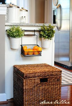 This towel bar is snuck onto a kitchen island, a hanging bin holds clementines, ready to grab as you run out the door.