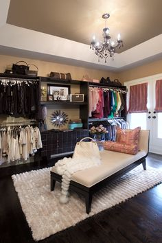 Turn small bedroom into Closet / Dressing Room--a girl can dream. This would be great for couples that work totally different hours. I hate waking up early and having to turn a light on and get dressed while my honey is still trying to sleep.