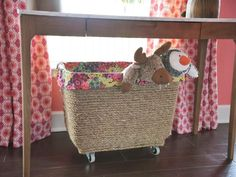 Mobile and Mess-Free Storage  Don't throw out an old plastic bin just when it starts to show some wear and tear. Instead, cover it with durable jute rope and add metal casters to create your own mobile toy box. It's never been easier or more fun for kids to clean up after themselves! Upcycle, recycle