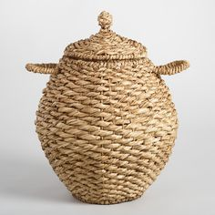Golden water hyacinth takes stunning shape in our eye-catching oval basket. Fitted with sturdy handles and a snug-fitting lid, it's perfect for keeping odds and ends neatly tucked out of sight.