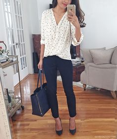 business casual office outfit idea: wrap polka dot blouse + navy ankle pants for…