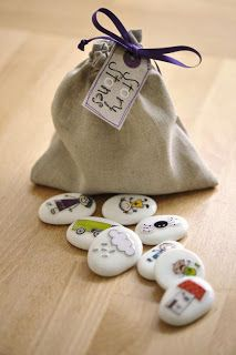 "Story Stones : She is not currently selling these but they would be easy to do for yourself. You could mod podge small pictures on paonted stone or even use those rub on tatoos. I've seen the block ones but I love the idea on stones. You could have them ""find"" them in the yard to make up their story."