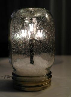 Narnia snow globe Dollhouse, Train, or Village Light Snow-globe Miniature in Mason Jar | Crafts from putitinajar.com + mason jars, mason jars, mason jars.